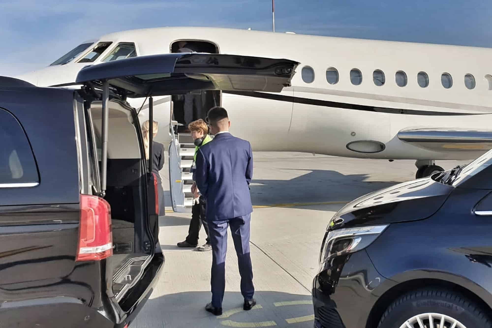 Chauffeur picking up passengers from the private jet at the Krakow Airport