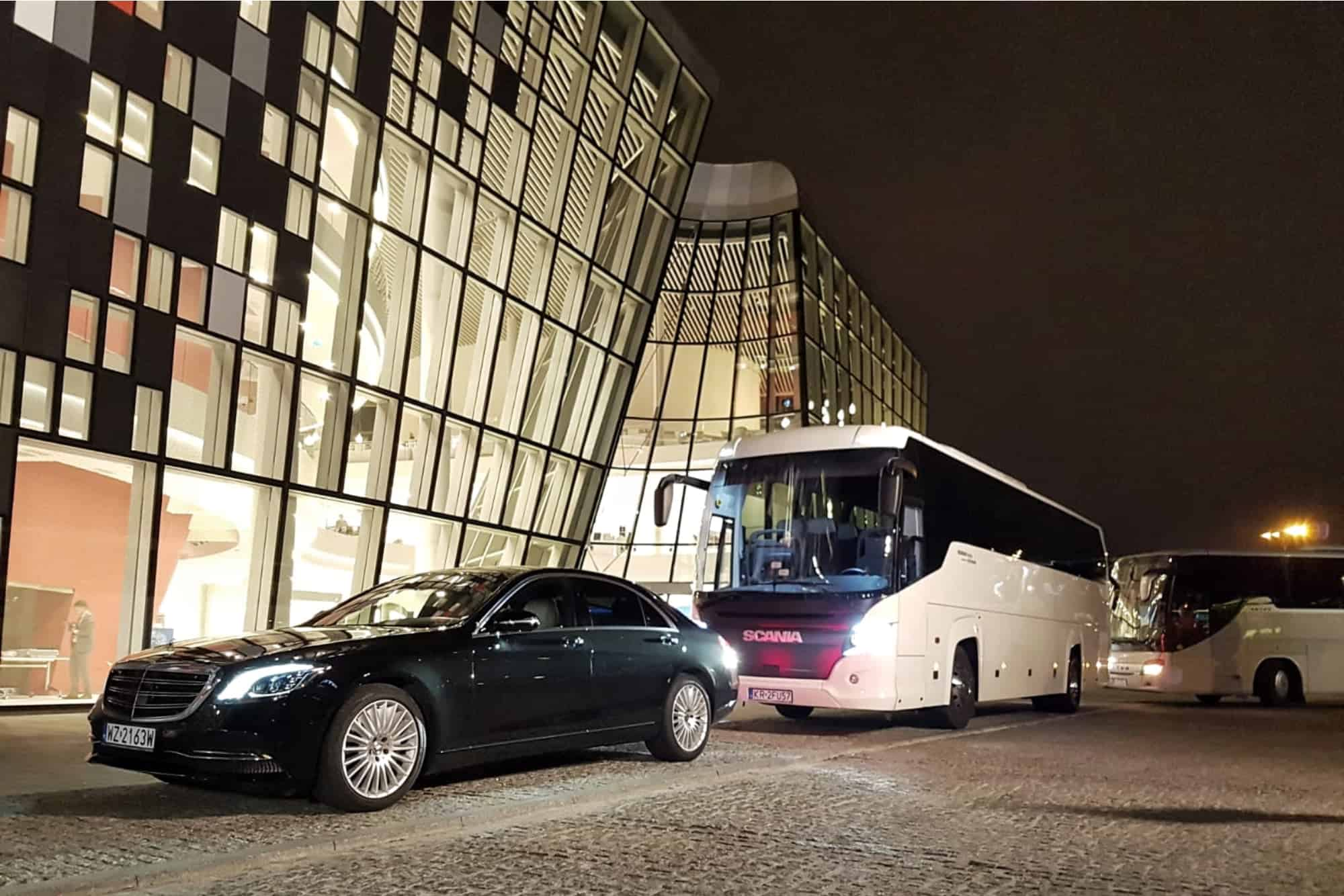 Mercedes-Benz S-class limousine with 50-seater coach in front of the International Congress Centre in Krakow
