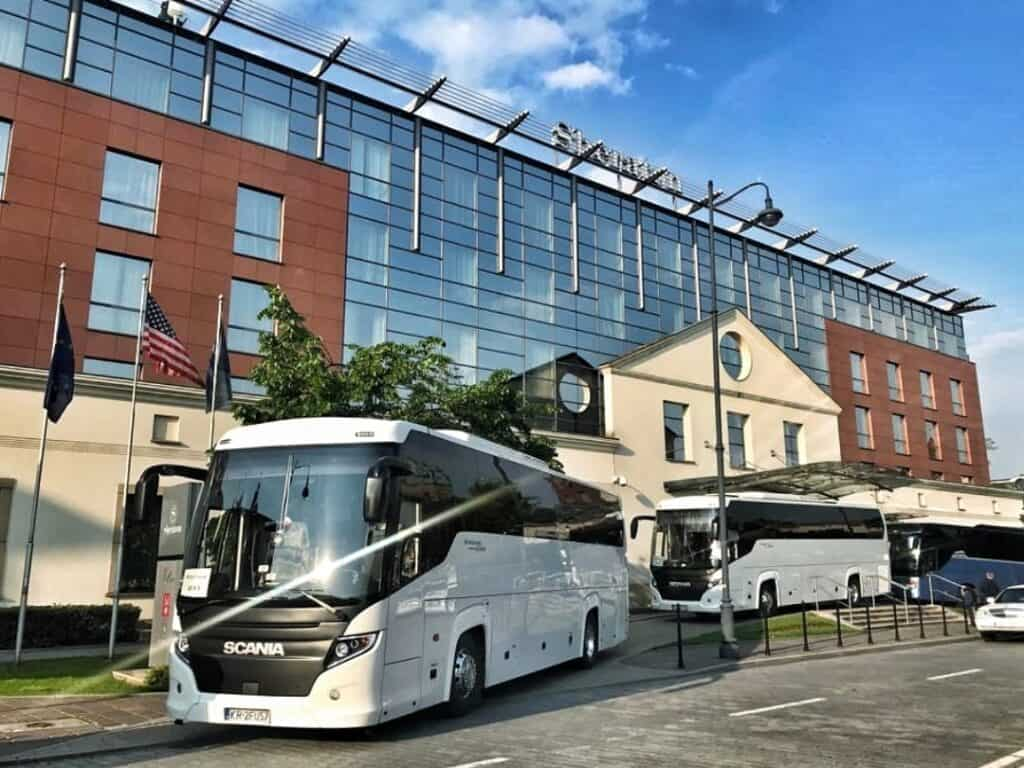 50-seater coach with driver hire ready for passengers at Sheraton Grand Krakow