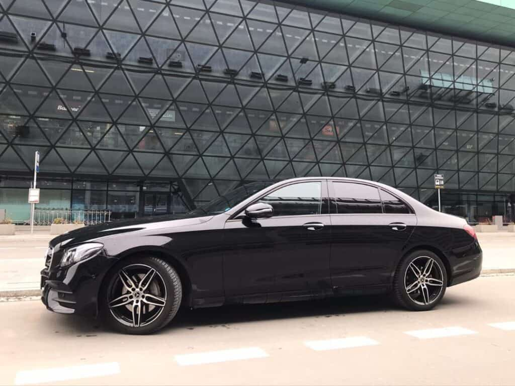Limousine with driver hire Mercedes-Benz E-class side