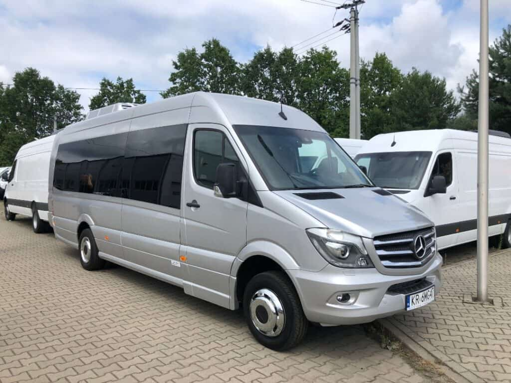 Front of the Mercedes-Benz Sprinter, minibus with driver for hire in Krakow