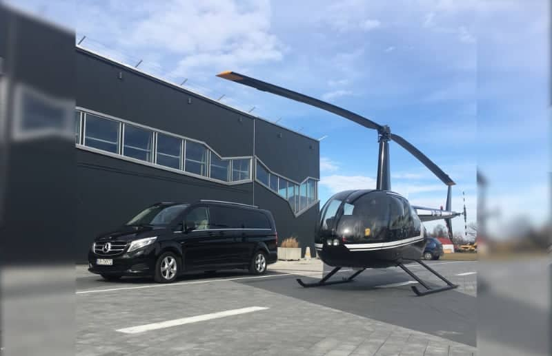 Rent a car or book a ride with our black minivan to a helicopter in Krakow and Warsaw, Poland
