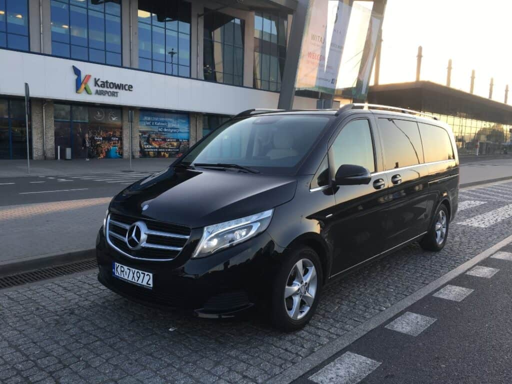 Minivan with driver hire parked Katowice Airport Mercedes-Benz V-class